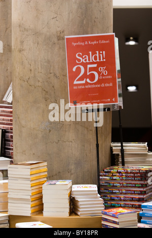 Wintry sales in January, discounts cartels on window store in hight street in the center of Rome city Italy shopping - Stock Photo