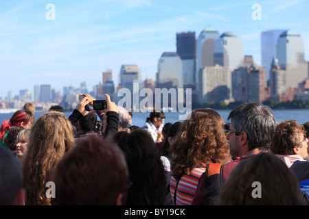 Tourists taking pictures of the skyline, New York City, United States of America - Stock Photo