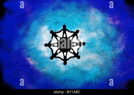 One world unity symbol made with a stencil and coloured powder - Stock Photo