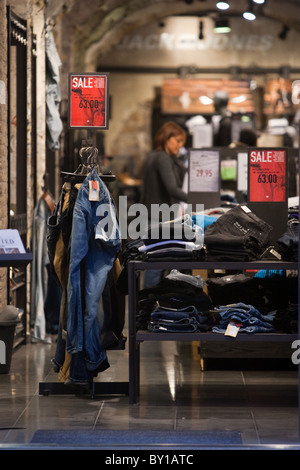 Wintry sales in January, discounts cartels display store in hight street in the center of Rome city Italy shopping - Stock Photo