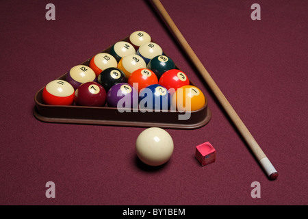billiard pool table with cue stick triangle and balls - Stock Photo