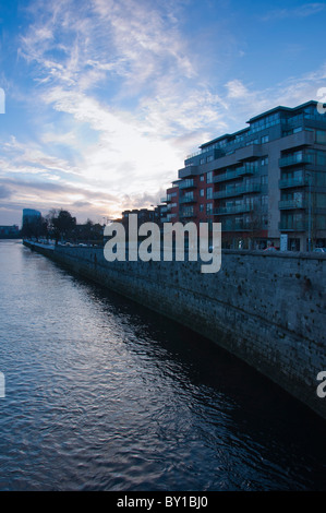 The 5 star Strand hotel next to modern apartment on the banks of the river Shannon in Limerick city, Republic of - Stock Photo