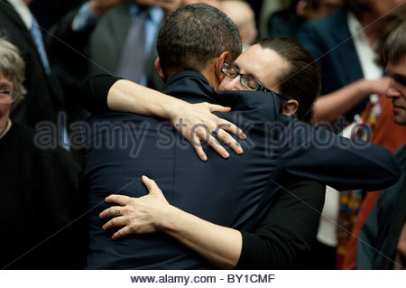 President Barack Obama hugs Mellisa Kay Gilbert, the sister of Gabrielle Giffords who was wounded  shooting in Tucson - Stock Photo
