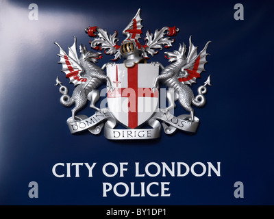City of London Police emblem on dark blue background shot at Barbican towers domine dirige nos god guides us - Stock Photo