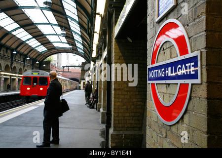 Circle Line train arriving at Notting Hill Gate tube station, Notting Hill, London, UK - Stock Photo