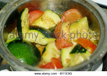 Cook pot filled with local vegetables frying in extra virgin olive oil - South Africa - Stock Photo