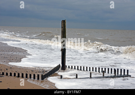 Wooden groynes, Caister-on-Sea, Norfolk, England. - Stock Photo