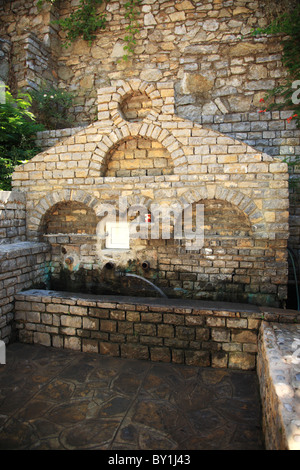 Old drinking water fountain in a village square, Turkey - Stock Photo