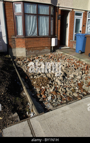 Home renovation: preparing foundation before laying concrete on a front garden - Stock Photo
