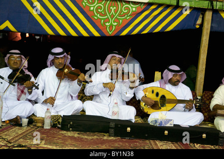 saudi arabian musicians play violin and oud at traditional