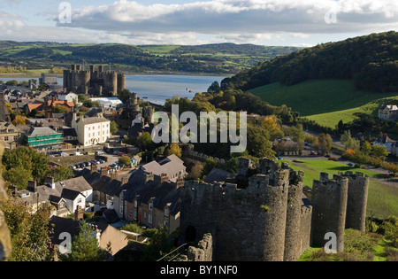 UK, North Wales; Conwy. View of the town and castle with the Conwy River behind. - Stock Photo