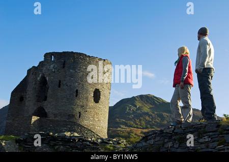 UK; North Wales; Snowdonia;  Couple sightseeing at Dolbadarn Castle, Llanberis. (MR) - Stock Photo