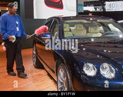 Worker Dusts Bentley Flying Spur at Detroit Auto Show - Stock Photo