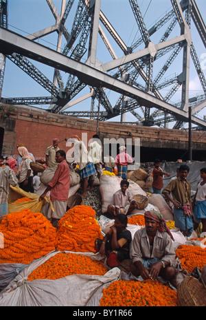 Flowermarket near Howrah-Bridge in Calcutta (Kolkata), India - Stock Photo