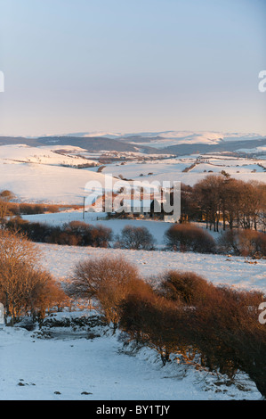 Isolated farmhouse in a snow covered landscape near Aberystwyth Ceredigion Wales UK on Christmas Day 2010 - Stock Photo