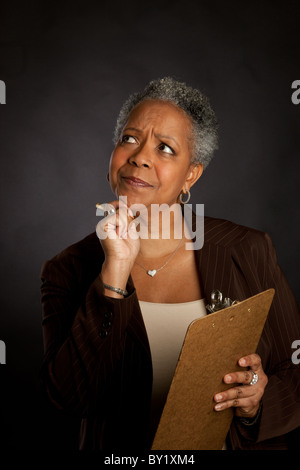 African American woman with clipboard - Stock Photo