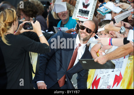 Actor Jason Statham arrives for the premiere of 'The Expendables,' on Monday night, August 9, 2010, at the Odeon, - Stock Photo