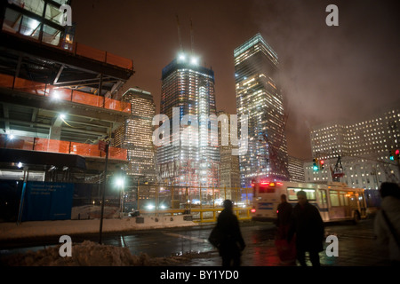 The under construction Freedom Tower, center, and other development at Ground Zero in New York - Stock Photo