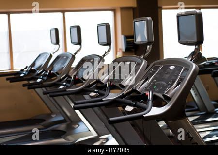 Row of exercise treadmills - Stock Photo