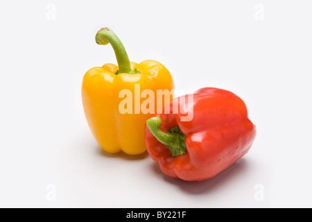 Close-up of two pure sweet peppers over white background - Stock Photo