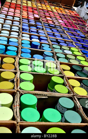 Spraypaint cans in a market in Amsterdam - Stock Photo