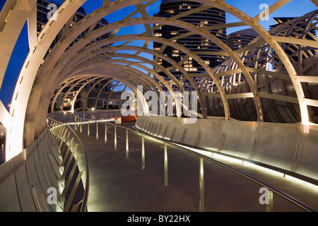 Australia, Victoria, Melbourne, Docklands.  The Webb Dock Bridge at night, its design inspired by Koorie fish traps. - Stock Photo