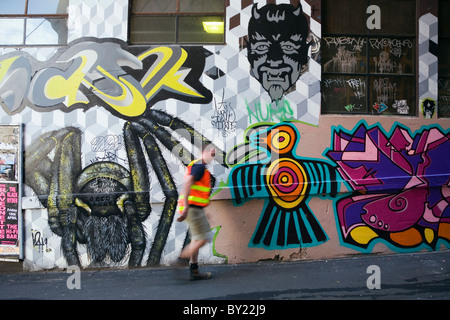 Australia, Victoria, Melbourne.  Colourful street art in Hosier Lane.. - Stock Photo