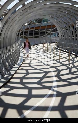 Australia, Victoria, Melbourne, Docklands.  Pedestrian crossing the Webb Dock Bridge. - Stock Photo