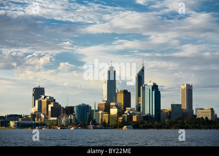 Australia, Western Australia, Perth.  View across the Swan River to the city skyline at dusk. - Stock Photo