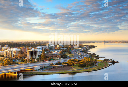 View across the Swan River,  South Perth and Como. Taken from Kings Park at sunrise. - Stock Photo