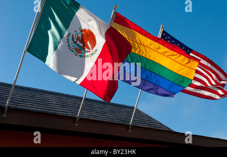 Gay Rainbow, Mexican and American flags on display in Gay Castro district of San Francisco California - Stock Photo