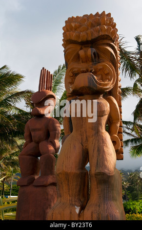 Wooden statues Polynesian artwork from the entrance to Polynesian Cultural Center on East Coast of Oahu Hawaii - Stock Photo