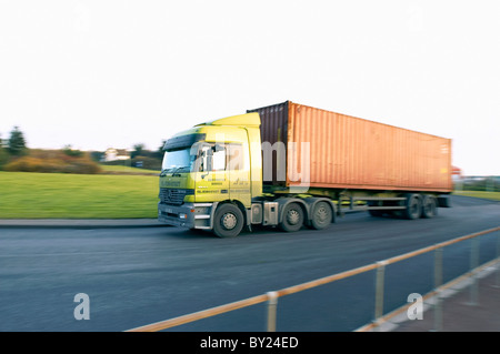 Articulated container truck on the road Stock Photo ...