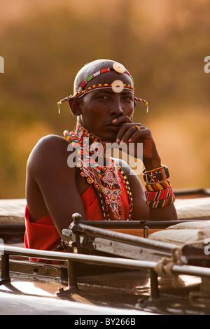 Kenya, Masai Mara National Reserve.  A safari guide spotting for tourists whilst out on safari. - Stock Photo