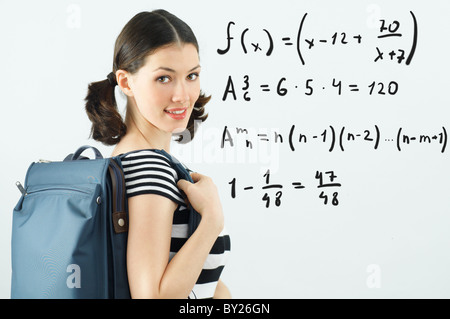young beautiful girl standing by the board - Stock Photo