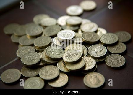 Pile pound coins - Stock Photo