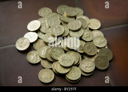 Pile pound coins - Stock Photo