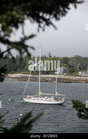 A sailboat drifts on the open waters of Acadia National Park in Acadia, Maine. - Stock Photo