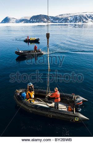 Polar guides driving motorized inflatable boats, Phippsoya Island, Sjuoyane, The Seven Islands, Spitsbergen/Svalbard, - Stock Photo