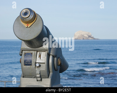 A coin operated telescope looking out to the Bass Rock from the town of North Berwick in Scotland. - Stock Photo