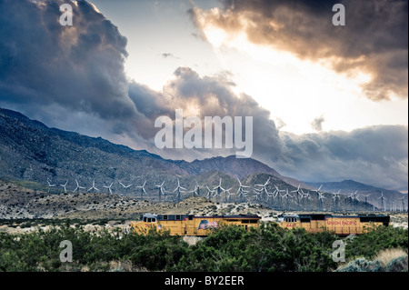 Windmills and a freight train at San Gorgonio Pass near Palm Springs, California. - Stock Photo