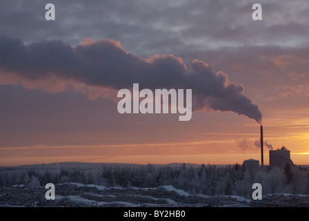 Sun barely rising above the horizon during the cold, short arctic winter day at  Rovaniemi, Finland on 24. of December. - Stock Photo