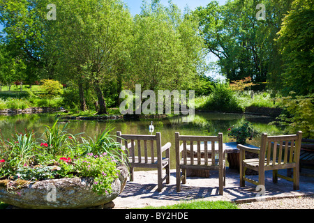 A large ornamental pond or small lake in an English country garden in summer - Stock Photo