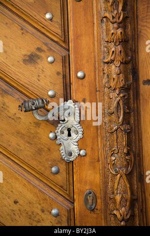 An ornate door handle and door posts in Prague, Bohemia, Czech Republic - Stock Photo