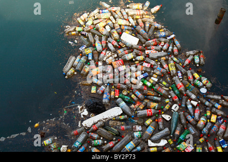 Plastic Bottle floating at the Baie de la Moselle in Noumea New caledonia. - Stock Photo