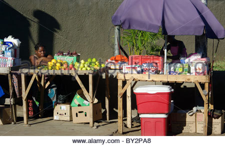 Shopping in Maputo Mozambique Africa - street marker fruits seller fresh fruits stall stalls - Stock Photo