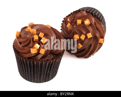 Tasty Authentic Chocolate Cup Cakes With Caramel Chunks And Fondant Icing Desserts Against A White Background With - Stock Photo