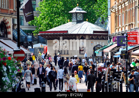 View along busy pedestrianised Irving Street looking towards popular tkts theatre ticket booth in Liecester Square - Stock Photo