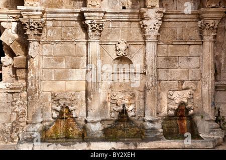 The Rimondi fountain, a Venetian survival in Rethymno's backstreets, Rethymno, Crete, Greece - Stock Photo