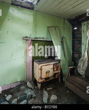 Wood burning stove in derelict croft house, Berneray, Outer Hebrides, Scotland - Stock Photo